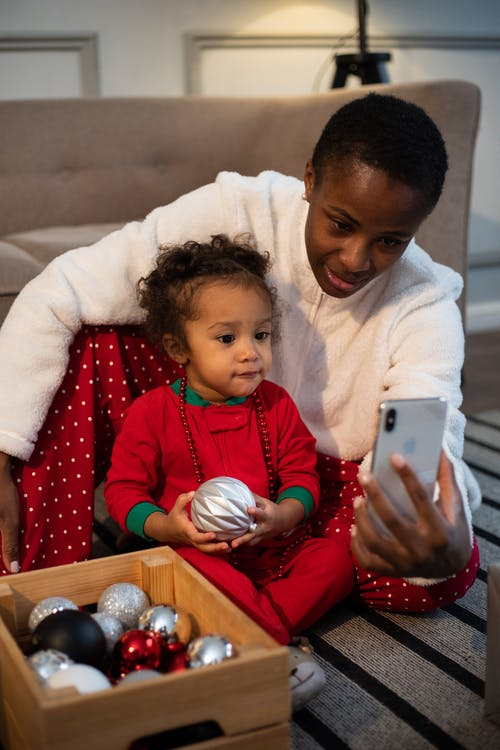 Woman And Little Girl On A Video Call