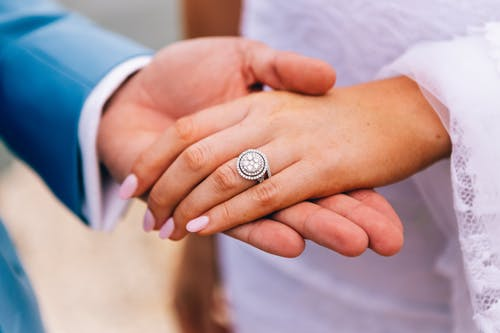 Person Wearing Silver and Black Diamond Ring