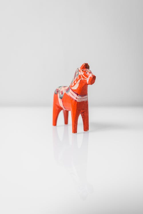 Red and Brown Ceramic Figurine