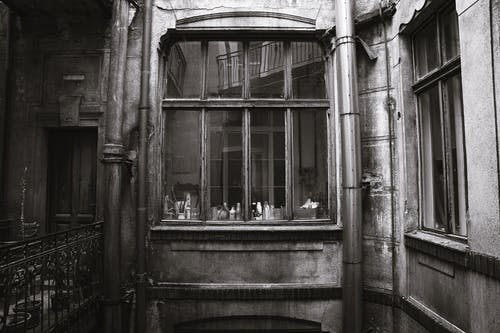Grayscale Photo of Wooden Window
