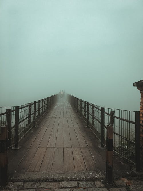 Brown Wooden Bridge with Thick Fog