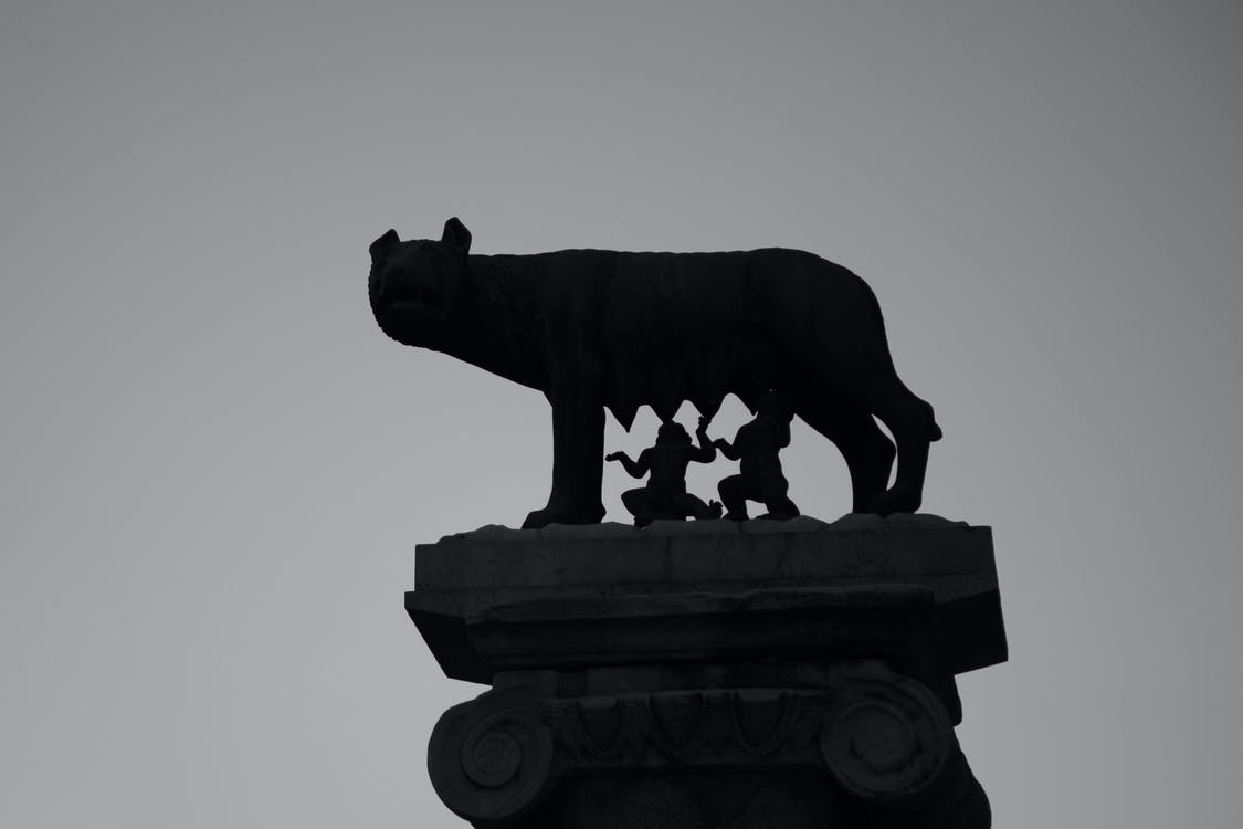 Ancient sculpture of mythical Romulus and Remus