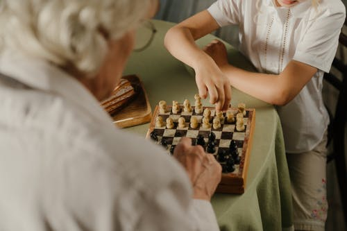 Person in White T-shirt Playing Chess