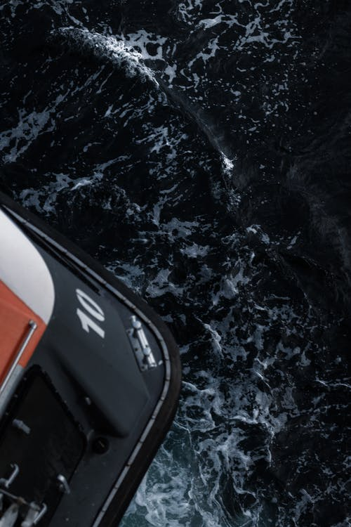 White and Orange Boat on Water