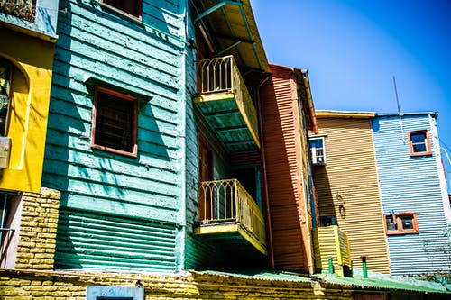 Low Angle Photography of Blue and Brown House