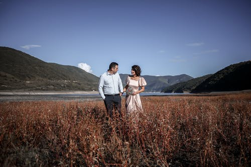 Romantic elegant couple in valley with mountains