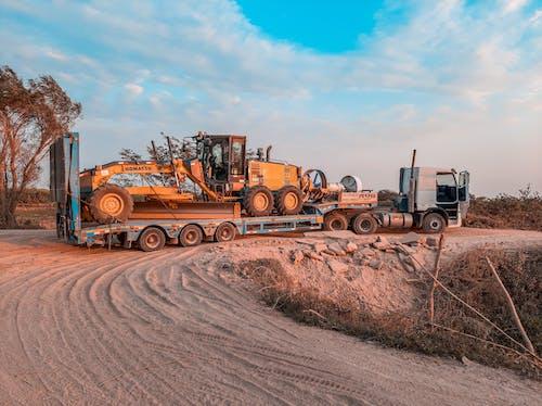Fotos de stock gratuitas de camino de tierra, camino sin asfaltar, camión
