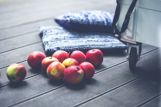 Red apples on the floor
