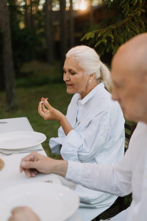 Elderly Woman Eating Food