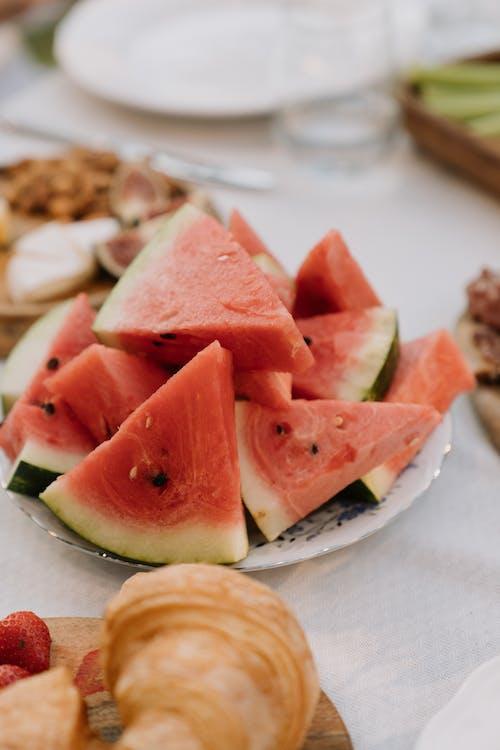 Sliced Watermelon on White Ceramic Plate