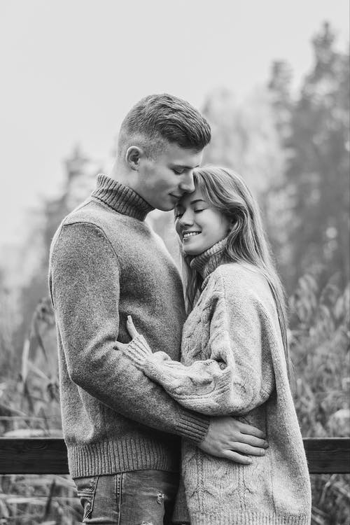 Grayscale Photo of a Romantic Couple
