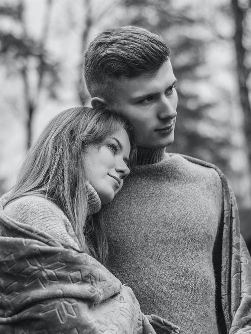 Grayscale Photo of Romantic Couple Standing Close to Each Other