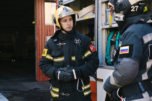 Firefighters Talking while Standing