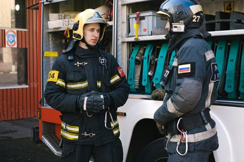 Firefighters Having a Conversation while Standing
