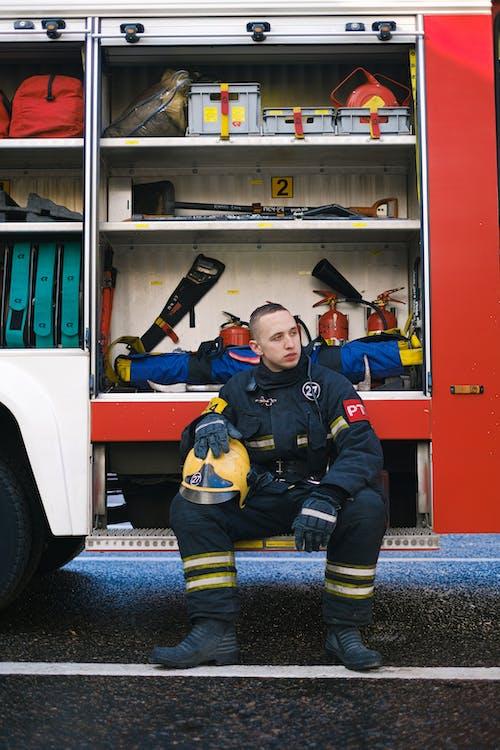 A Fireman Sitting on a Fire Truck