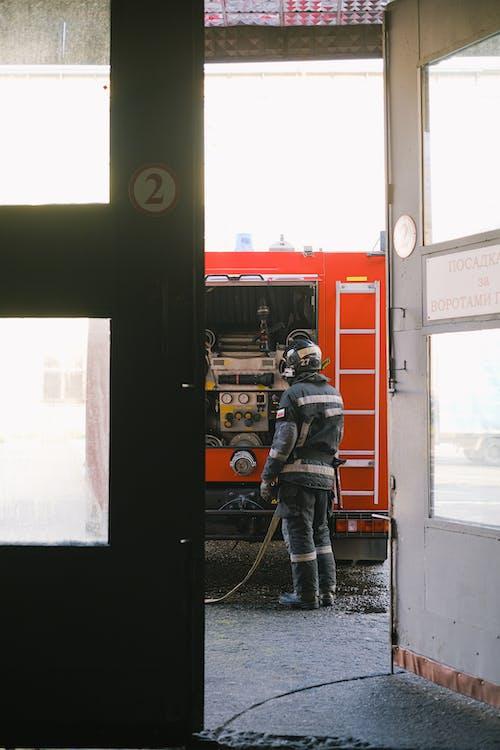 Man Standing Behind a Fire Truck