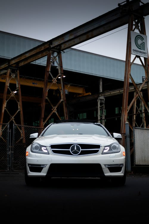 White Bmw M 3 Coupe Parked on Garage