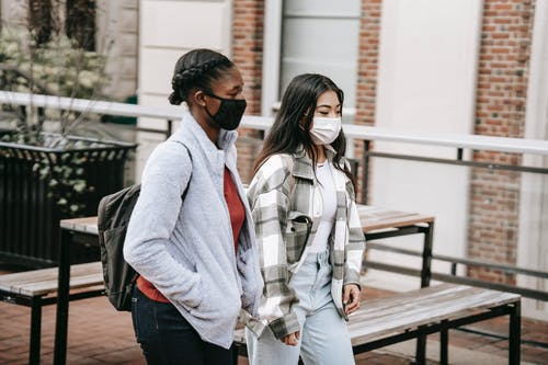 Diverse students walking near table in campus