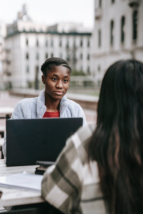 Serious black woman at table with partner