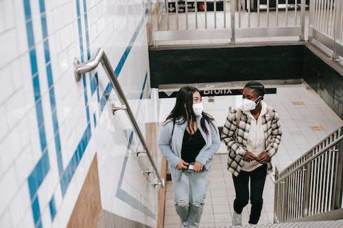 Diverse friends walking upstairs in underground