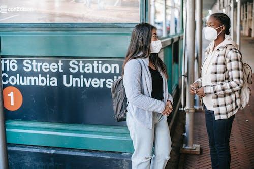 Diverse women standing near metro entrance