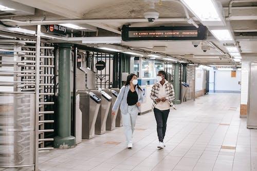 Diverse women walking in spacious underground