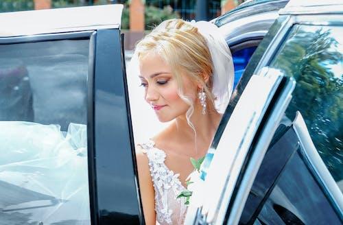 Gorgeous bride sitting in fancy car