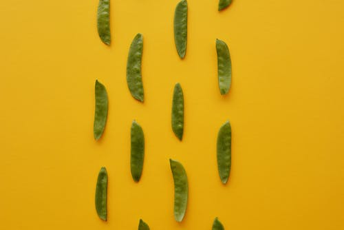 Green Peas on Yellow Background