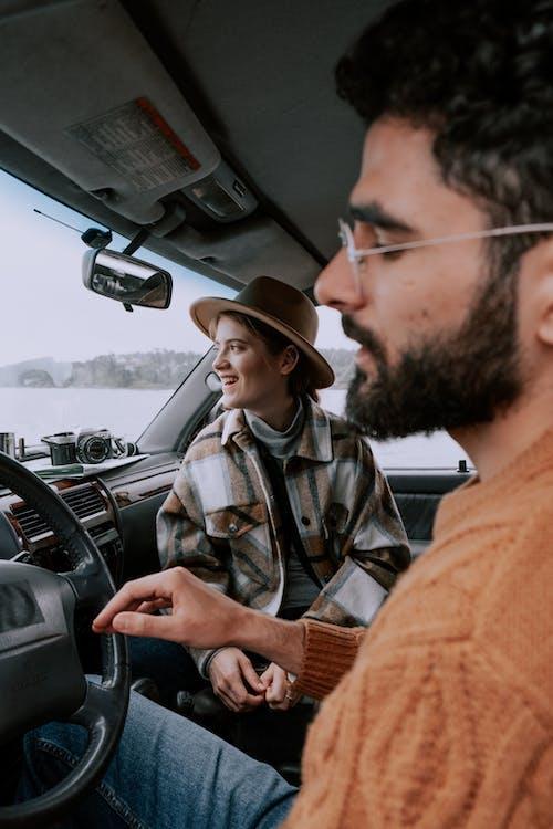 Man in Brown Hat Driving Car