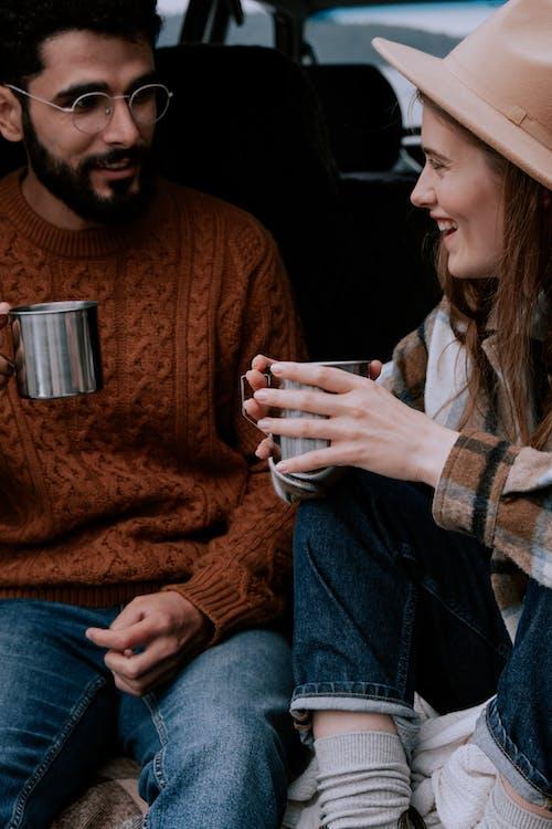 Woman in Brown Sweater Holding White Ceramic Mug
