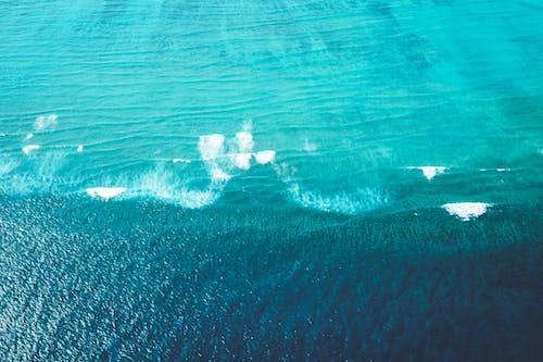 Azure sea with foamy waves