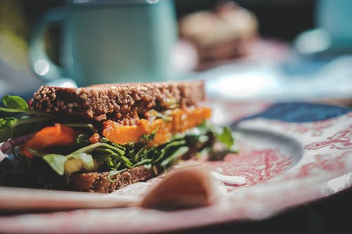 Delicious vegetarian sandwich with mixed leaves and tomatoes