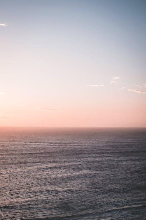 Blue rippling ocean under clear blue sky