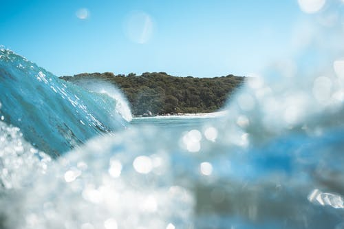 Splashing clear wave on sea in tropics