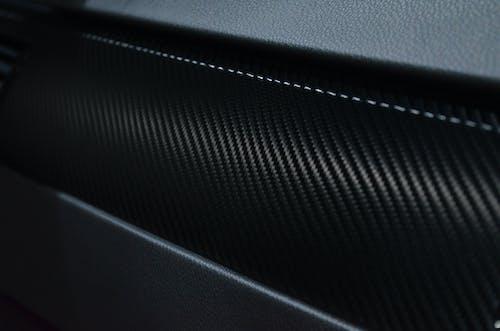 Foto profissional grátis de carbono, couro, design, escuro