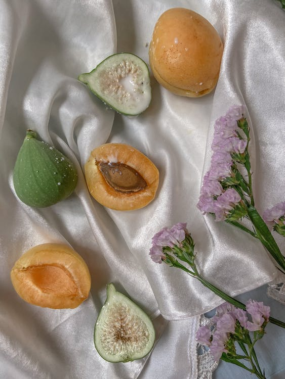 Ripe figs and apricots on textile