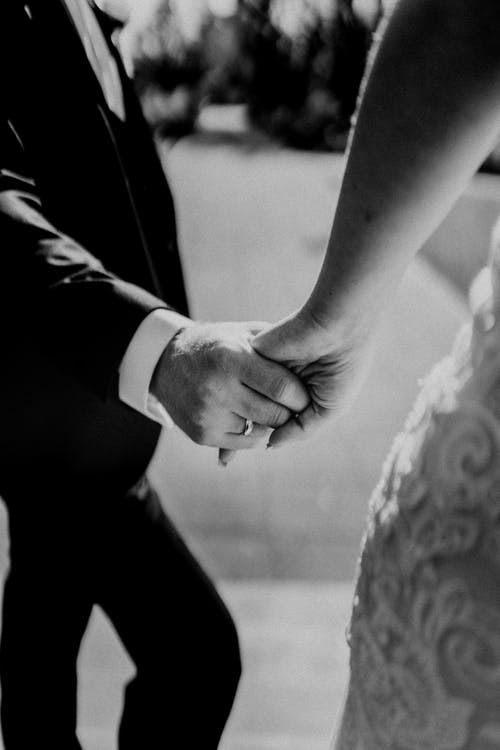 Monochrome Photo of Married Couple Holding Hands