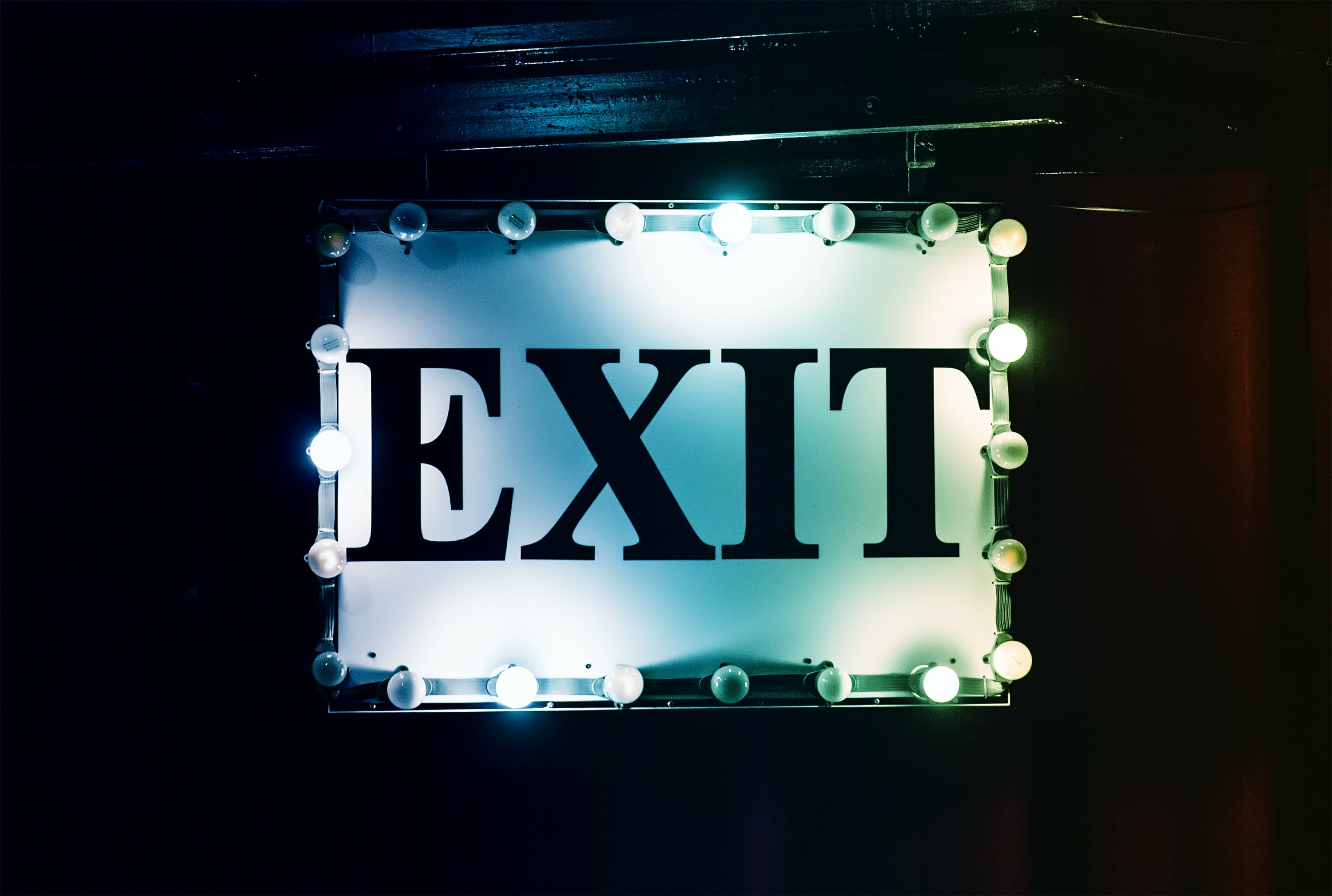 White and Black Lighted Exit Signage