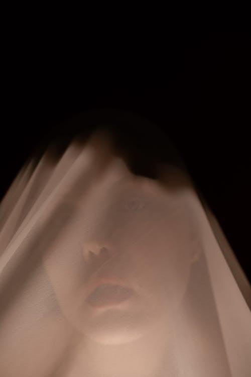 Calm woman under white veil