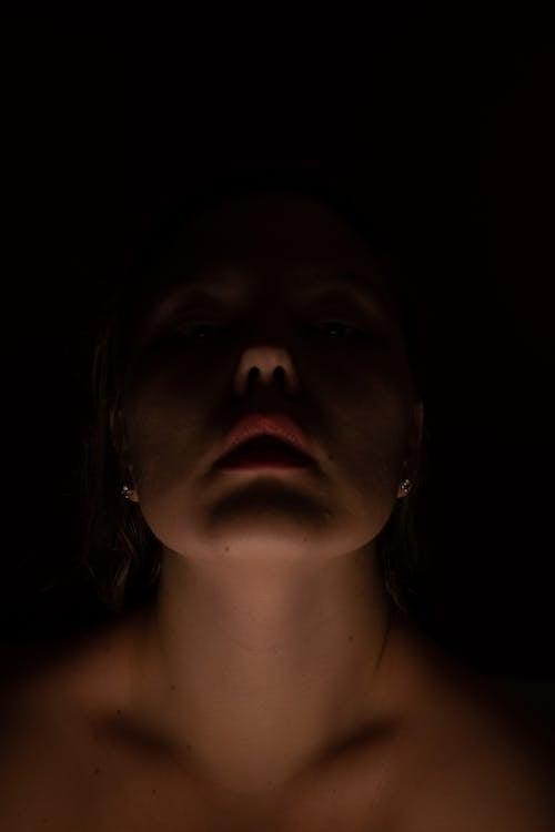 Crop woman standing in darkness