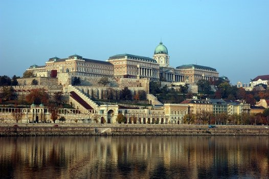 Buda Castle Near Body of Water Under Blue Sky during Daytime