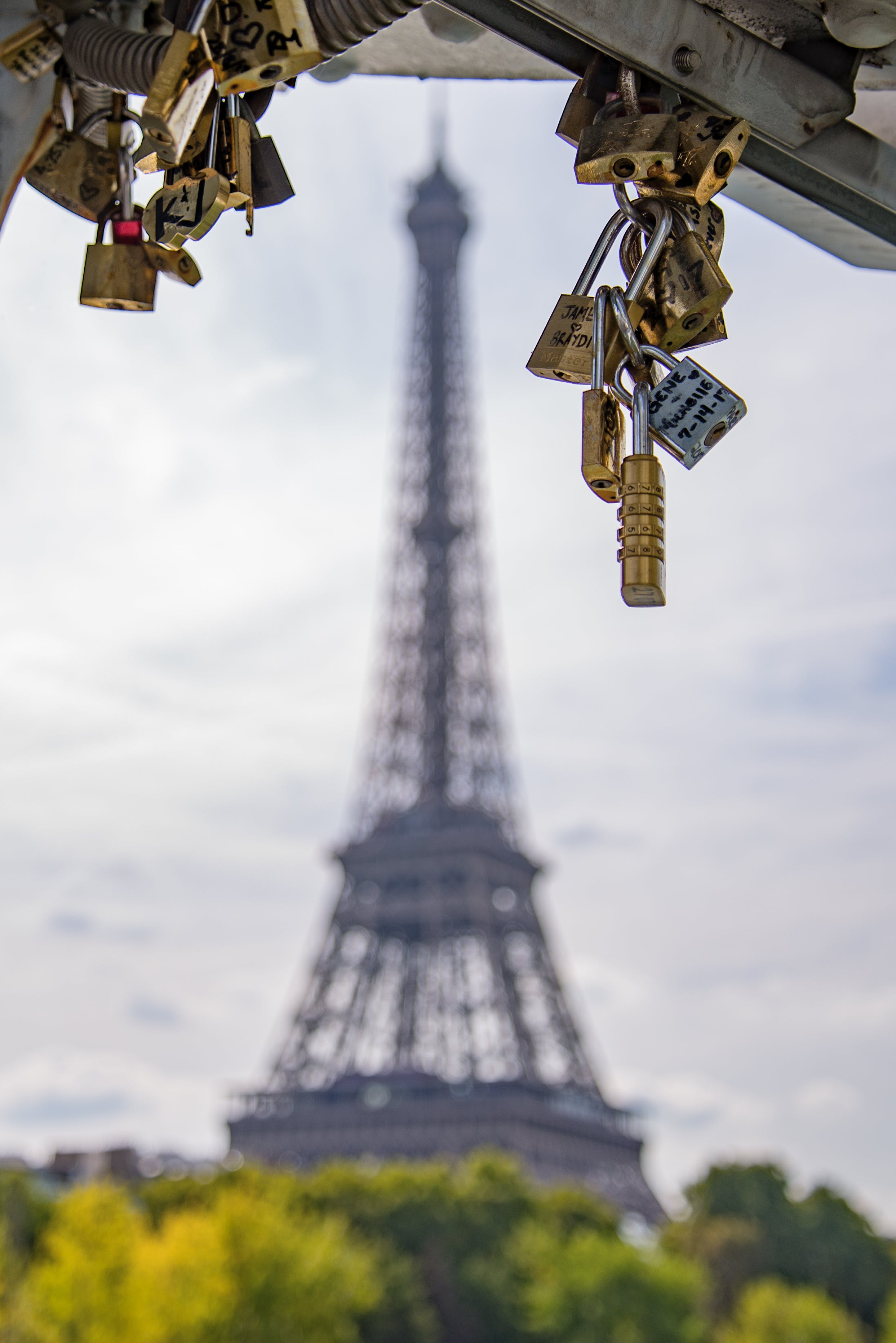 Selective Focus Photography of Padlocks With Eiffel Tower in Background
