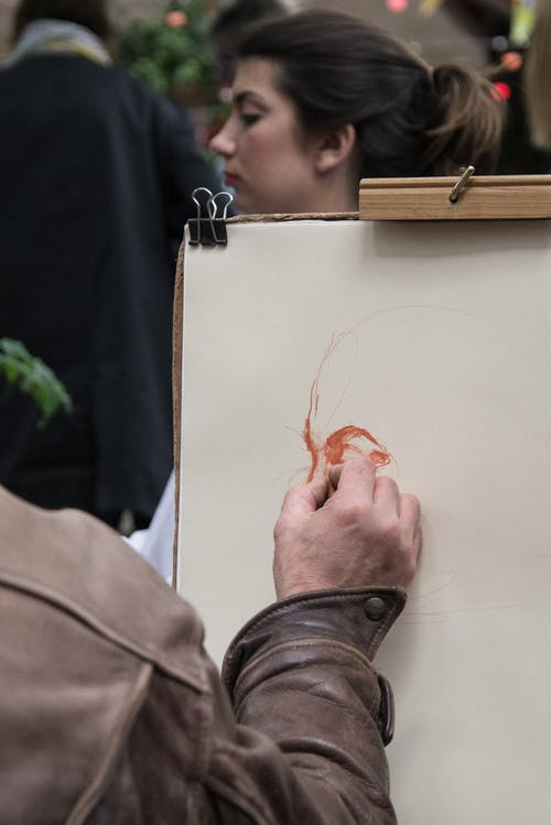 Person Sketching Woman's Face