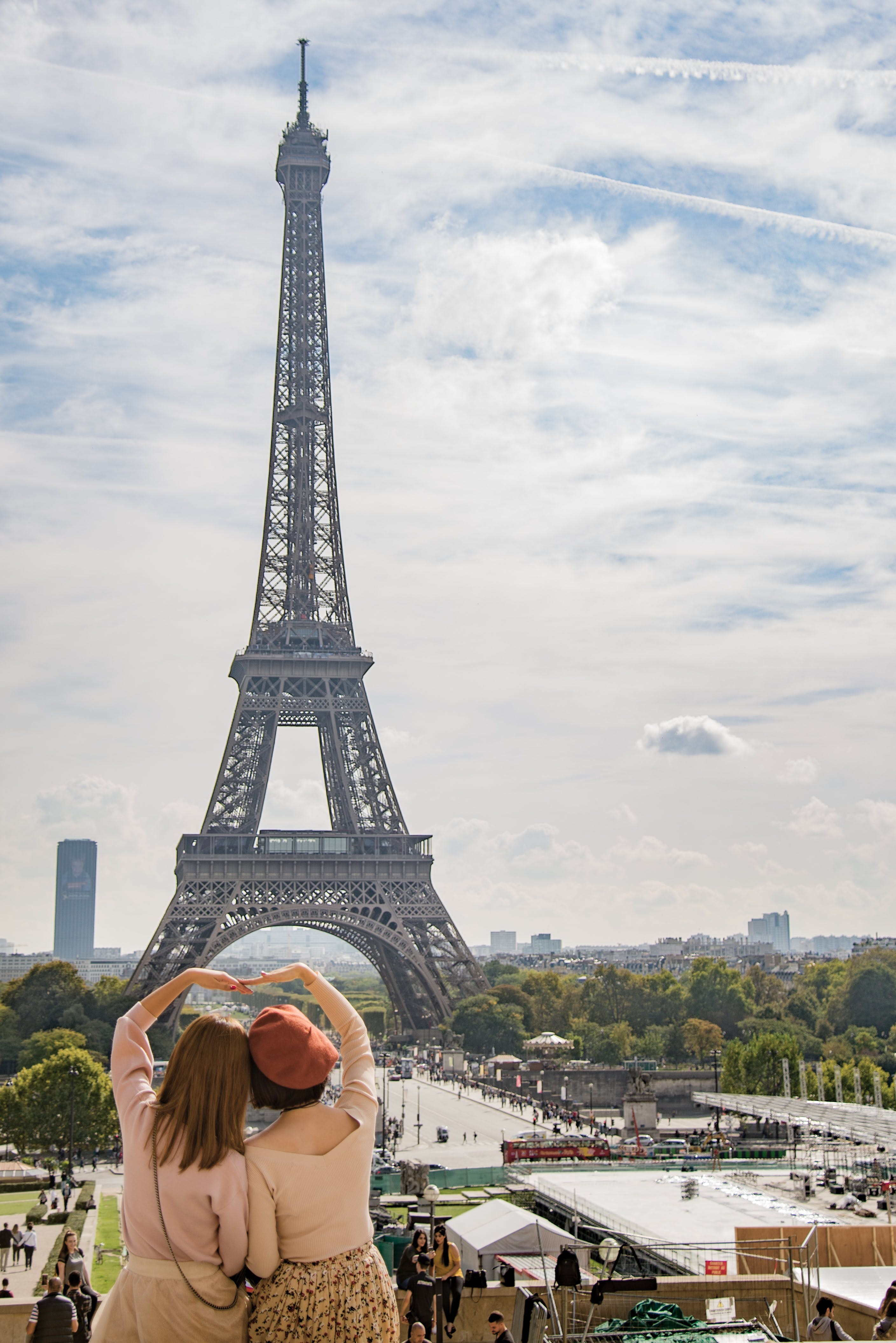 Photo of Two Women Posing in Front of Eiffel Tower, Paris, France during Day Time
