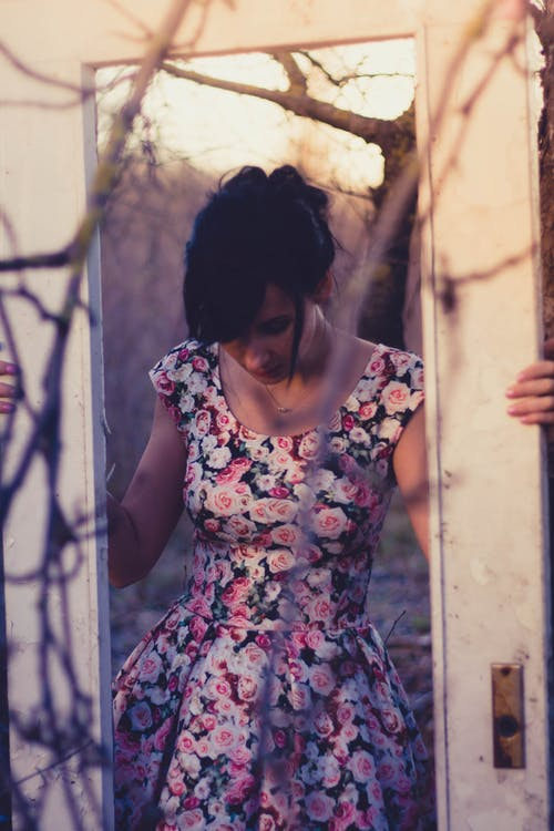 Woman Holding White Wooden 1-lite Door