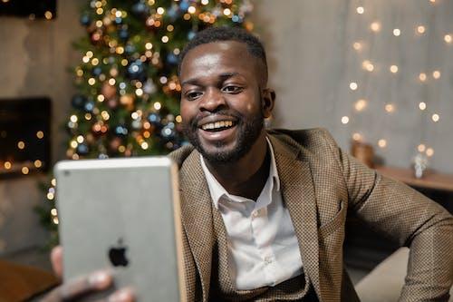 Man in Brown Suit Jacket Smiling