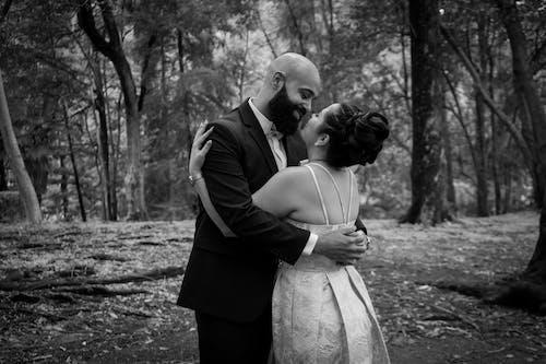 Monochrome Photo of a Romantic Couple Hugging