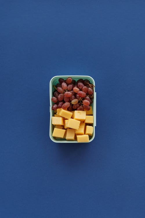 Yellow and Pink Square Candies in Blue Container