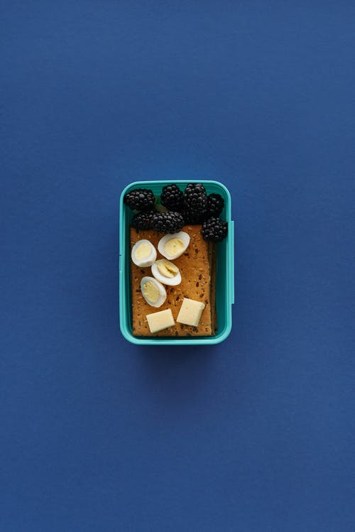 Blue Plastic Container With Brown and White Stones
