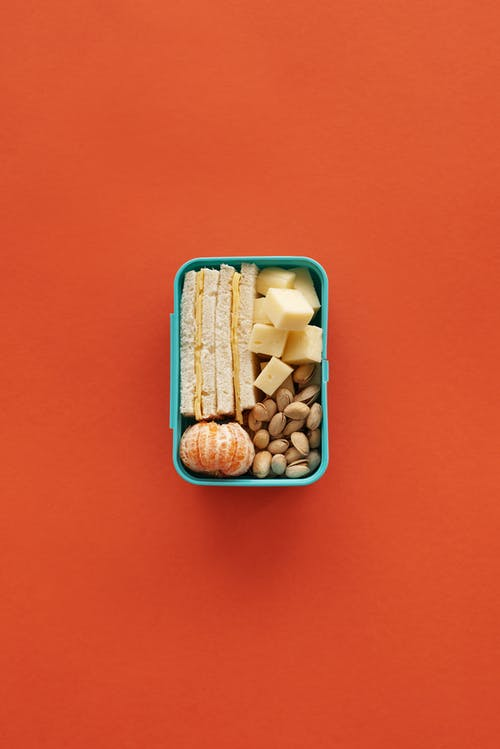 Brown and White Beans in Blue Plastic Container